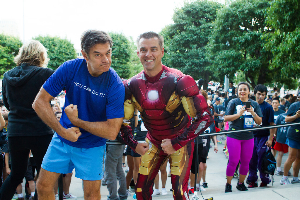 Dr. Oz and USANA CEO Dave Wentz showing their muscles.