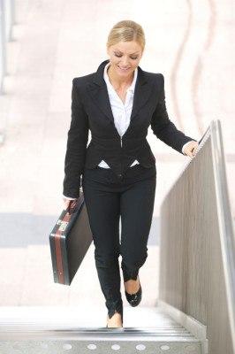 Businesswoman walking upstairs with briefase